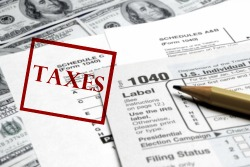 bigstock-Current-tax-forms-and-pencil-o-58757438